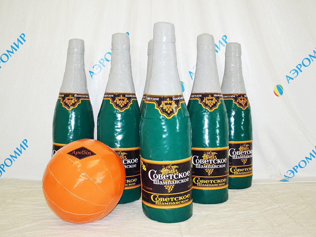 Big bowling in the form of bottles with Champagne and a mandarin-ball