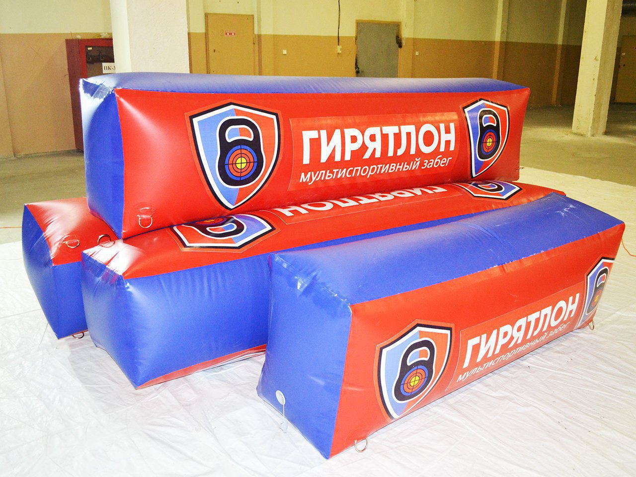 A set of paintball players branded gyryatlon